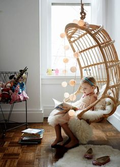 Charlie in her Hanging Rattan Chair, via @joannagoddard. #serenaandlily