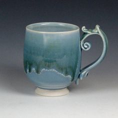 Handmade porcelain mug with a frosty blue exterior and white interior glazes. Comfortably holds Measurements: All clay and glazes used are food safe, dishwasher safe, and microwave safe. Porcelain Mugs, Ceramic Cups, Elvish, Pottery Mugs, Tea Bowls, Safe Food, Unique Gifts, Handmade Items, Clay