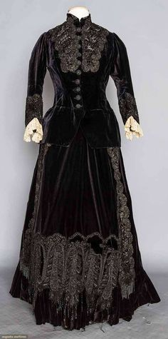Evening dress, black velvet fitted bodice and bustle skirt, both with elaborate jet beaded appliques & jet buttons, 1870s