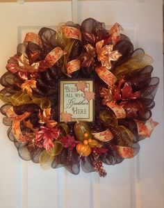 This wreath measures approximately 24 in diameter. It is adorned with beautiful metallic leaves and elegant leaf ribbon. Sign in center is made