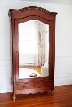 ❤this Armoire...with a huge beveled mirror...A Country Farmhouse: The Nursery