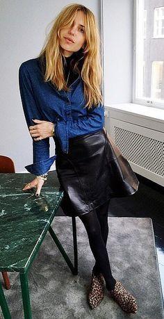 leather skirt, denim shirt and black turtleneck...