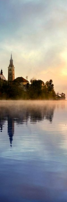 Lake Bled * SLOVENIA *** The lake surrounds Bled Island (Blejski otok). The island has several buildings, the main one being the pilgrimage church dedicated to the Assumption of Mary (Cerkev Marijinega vnebovzetja), built in its current form near the end of the 17th century, and decorated with remains of Gothic frescos from around 1470 in the presbyterium and rich Baroque equipment. #Posted on 11.4.2017 by admin