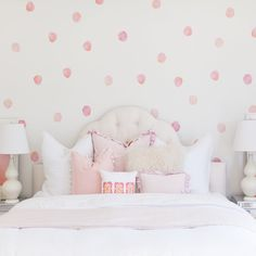 Giving your nursery the look of a custom-painted polka dot wall, these watercolor vinyl wall decals are chic and playful at the same time. Dimensions & Details: - Includes 50 individual dots - Each do