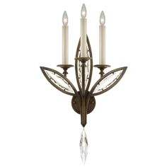 844650-32ST | Fine Art Lamps  Elegant and graceful sconce in antique hand rubbed bronze finish with antiqued candlesticks and hand cut faceted crystals.