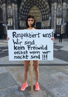 "Swiss performance artist Milo Moire holds a sign reading, ""Respect us!"" Institutions, religious, cultural, or otherwise, that want power over women is part of the entire problem. Photo Gallery: Islam Clashes with Women's Rights in Germany"