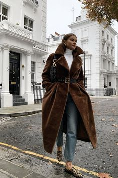 What to wear in December: Rikke Krefting in a brown faux fur coat with jeans
