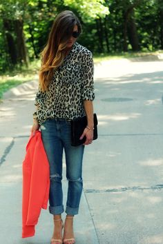 animal print blouse, jeans and heels
