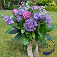 A lovey summer mixture of purples and mauves including scented stocks, alliums and roses Fresh Flowers, Silk Flowers, Flower Wall Design, Anniversary Flowers, Sympathy Flowers, Event Company, Silk Flower Arrangements, Flower Bouquets, Wedding Book