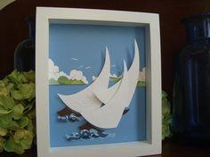 Cut paper sailboat art by SheilaShamelStudio on Etsy, $45.00