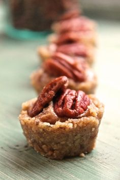 Raw Pecan Pie Tartlets - SO YUMMY!  Only 4 ingredients needed.  they are tedious to make but there is no baking and they make a great guiltless sweet fix!!