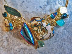 Boulder opal, rainbow hematite drusy, titanium drusy, peruvian opal, pearl, tourmaline in 22k and 18k gold.  Opals from Bill Kasso, Eagle Creek