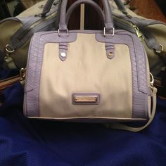 Steve Madden Satchel Cream and lavender satchel. Adjustable strap. Interior has one zippered pocket and two open pockets. Happy to consider reasonable offers! Steve Madden Bags Satchels