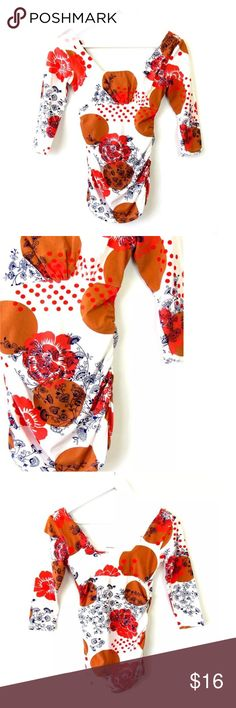 """CAbi Floral Dot Tee #955 Square Neck Sz XS Brand: CAbi Style: #955, Dot Tee, Grecian Floral Top with Square Neckline, 3/4 Sleeves, Ruched Sides Size: XS  Color:White, Coral, Navy, Bronze Material: 95% Cotton, 5% Spandex Measurements taken flat: -Across under arm: 14"""" -Shoulder to hem: 26"""" Garment Care: Machine wash, line dry  Condition: No flaws. See pictures for details. CAbi Tops Blouses"""