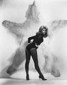 Cat suit 60s look with black seamed stockings - Elizabeth Montgomery. Love her hair!!
