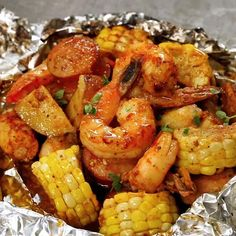 SHRIMP BOIL FOIL PACKS Ingredients 1 pound shrimp, peeled and de-veined 2 ears of corn on the cob, husked pound andou. Cajun Seafood Boil, Seafood Boil Recipes, Seafood Dishes, Seafood Boil Party, Seafood Broil, Cajun Shrimp Recipes, Lobster Boil, Shrimp Broil Recipe, Shrimp Boil Foil Packs