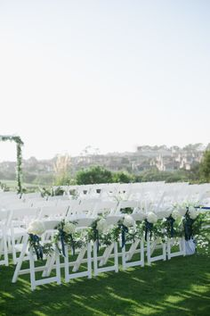 Garland for the ceremony chairs.   Photography: Hazelnut Photography - hazelnutphotography.com