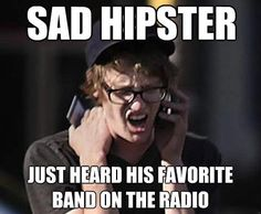 Sad hipster. Just heard his favorite band on the radio.