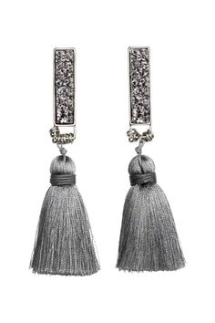 Tasselled earrings: Metal earrings with crystal-like plastic beads, small metal rings and fabric tassels. Length 10 cm.