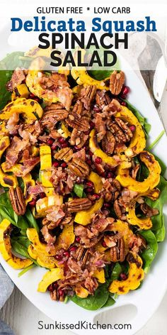 A hot holiday salad - Delicata squash spinach salad with bacon dressing, topped with pomegranate and pecans.