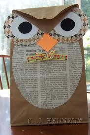 Paper  bag owl with paper scraps and old old books or newspaper