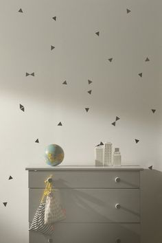 Affordable alternatives to wallpaper: Mini triangle wallsticker by Ferm: http://rstyle.me/n/byfgvx9ie