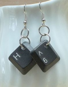 These pretty Earrings are a knock out. They are made with reclaimed computer keys and they hang from nickel free silver plated ear wires.  The