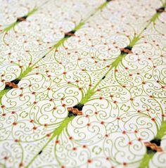 Handmade origami paper  Green spirals on pale green