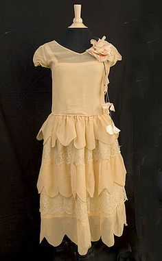 dress made of georgette fabric...again, note the scalloped hemline......dress has fabric flower which is making a comeback today in women's clothing