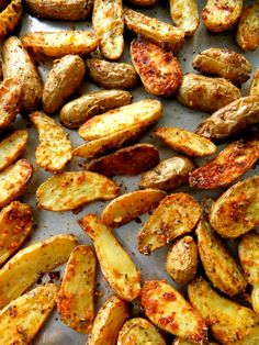 Roasted Fingerling Potatoes. Make a bunch because they go fast! No real recipe here just cut them in half, put them in a bowl and sprinkle them well with olive oil, oregano, garlic powder, paprika, rosemary, romano cheese, sea salt and pepper. Toss well and place on a baking sheet into a 425 hot oven until golden and crispy, keep checking and turning them. If you have a convection setting like I do, use that, they crisp up really nice and fast.