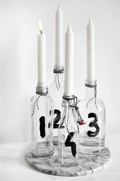 Candle holder centerpiece DIY made of glass bottles. Don't love the numbers? Try filling them with seasonal items.