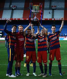 (From L to R) Marc Bartra (L), Ivan Rakitic (2ndL), Jordi Alba (3dL), Andres Iniesta (2ndR) and Sergio Busquets Burgos (R) of FC Barcelona hold the…