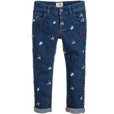 Boys blue jeans with embroidery by Gucci. Made in cotton with added elastane for stretch, these fun jeans have embroidered ducks, hares and stars all-over the fabric. They fasten with a hook and eye and have a logo button over, plus a zip. They have an adjustable waistband, five pockets, belt loops and turn-up cuffs.  Model in first image: Height 114cm (average 6 year)  Size of jeans shown in the photo: 6 years