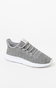 Inspired by the classic Tubular runner shoes, the Tubular Shadow Sneakers offer an intricate, tire-influenced outsole. These gray, women's sneakers are crafted from a soft knit upper with a cool 3D diamond pattern, while the longer tongue lends a snug fit.   	Mélange knit upper with 3D diamond pattern 	Burrito tongue for a snug fit 	Comfortable textile lining 	EVA midsole for lightweight cushioning 	Enjoy the comfort and performance of OrthoLite® sockliner 	Rubber outso...