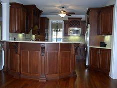 Wood corbel with inset iron Kitchen Cabinet Color Schemes, Cherry Wood Kitchen Cabinets, Cherry Wood Kitchens, Kitchen Cabinets Pictures, Staining Oak Cabinets, Dark Wood Cabinets, Kitchen Decor, Kitchen Design, Kitchen Ideas