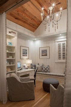 Small home office/den with reclaimed plank wood ceiling, vertical shiplap wainscoting and built-in cabinetry. Draperies add some privacy to the space.  Savoie Architects.
