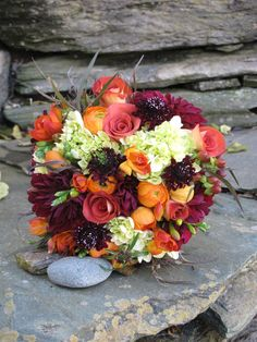 A joy to get and give...... orange and burgundy bridal bouquet for Vermont wedding