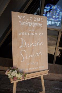 Wedding Welcome Sign. #woodenweddingsigns #welcomesign #weddingsign #welcometoourwedding #bespoke #finefollies #weddingsignage #signage #welcometotheweddingof #calligraphy #type #font #summerwedding #fresh #modern #design