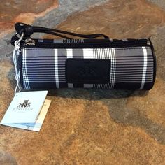 "NWT Rowallan Tartan Plaid Wristlet Authentic Rowallan make up bag. New, unused. Black and white nylon with silver hardware. 8"" long. 3"" diameter. Rowallan Bags Cosmetic Bags & Cases"