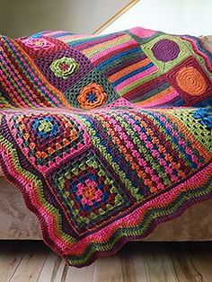 This vintage inspired afghan is a modern take on the retro granny square blanket…