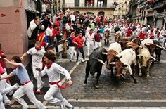 want to watch people running with the bulls in Spain....but i don't want to do it