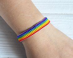 Items similar to LGBT Rainbow Bead Loom Bracelet with pride flag and adjustable chain, multi color pride rainbow jewelry, colorful lgbt gift on Etsy Diy Bracelets Easy, Bead Loom Bracelets, Loom Patterns, Beading Patterns, Lgbt Bracelet, Rainbow Pride, Rainbow Heart, Seed Bead Earrings, Friendship Bracelet Patterns