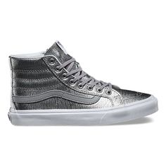 The Foil Metallic Sk8-Hi Slim, a slimmed down version of the legendary lace-up high top, features metallic leather uppers, signature waffle rubber outsoles, and padded collars for support and flexibility.