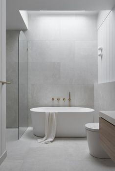 Soft grey tones create a calming Coastal bathroom We used light light grey tiles with VJ wall Panell Grey Bathroom Tiles, Bathroom Color Schemes, Grey Tiles, Bathroom Modern, Modern Small Bathroom Design, Interior Colour Schemes, Bathroom With Shower And Bath, Bathroom Tapware, Colorful Bathroom