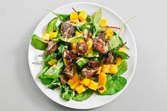 Salad with mango and a chicken liver.