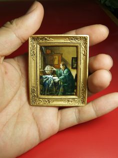 "Miniature reproduction work. Vermeer.""The Astronomer"" acrylic on cardboard."