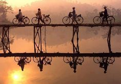 Indonesian villagers push their bicycles across a bamboo bridge as sun rises behind them outside Yogyakarta city in Central Java Photo Puzzle Pieces) Framed, Poster, Canvas Prints, Puzzles, Photo Gifts and Wall Art Yogyakarta, Bali, Vietnam Voyage, Bamboo Art, Natural Scenery, Bike Art, Mirror Image, Beautiful Sunset, Beautiful Pictures