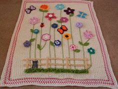 Crocheted child's afghan: Flower garden by Ruth Harlock Hunter (from No pattern.  Facebook link: https://www.facebook.com/photo.php?fbid=10150677640004654)