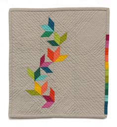 """I love the motion and colors here. It was fun! And tiny! Constructed entirely of American Made Brand cotton solids, AMB Tiny Quilt Challenge entries measure no larger than 15"""" x 15"""" yet their impact is mighty. Clearly size is no con…"""