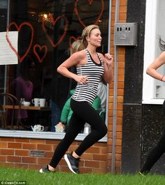 Bling! Even on the move, clues of Alex's extravagant lifestyle could be seen with her huge...
